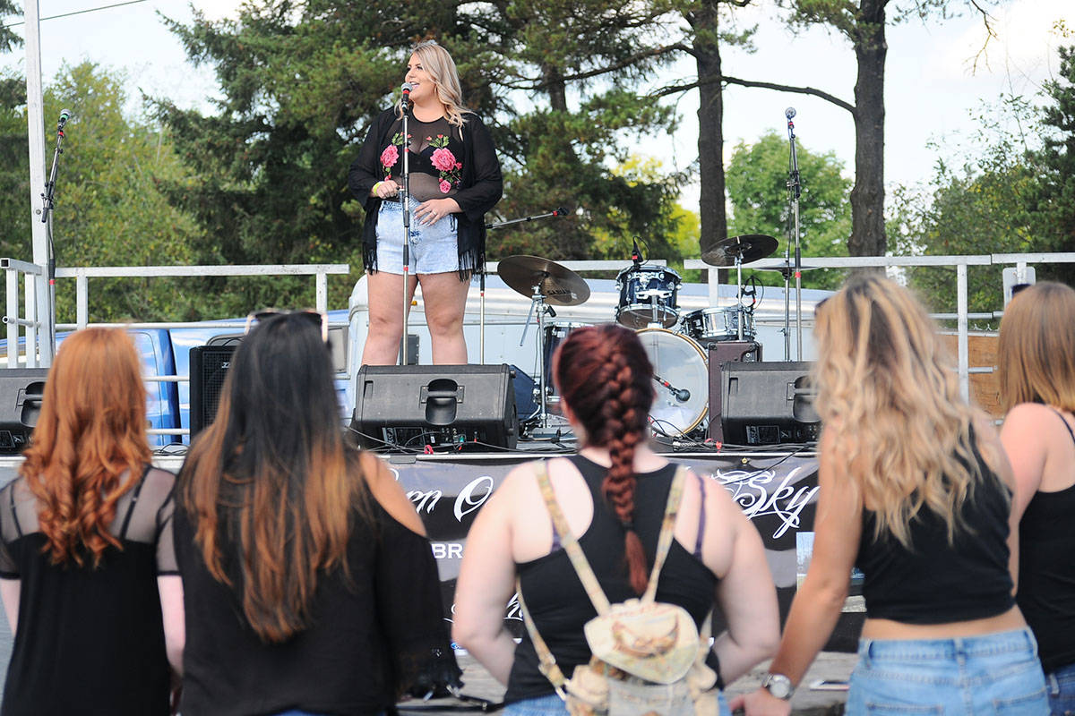 Bradley McPherson's younger sister, Mariah Simning sings to the crowd gathered at the Burnouts in the Sky event. (Aaron Hinks photo)