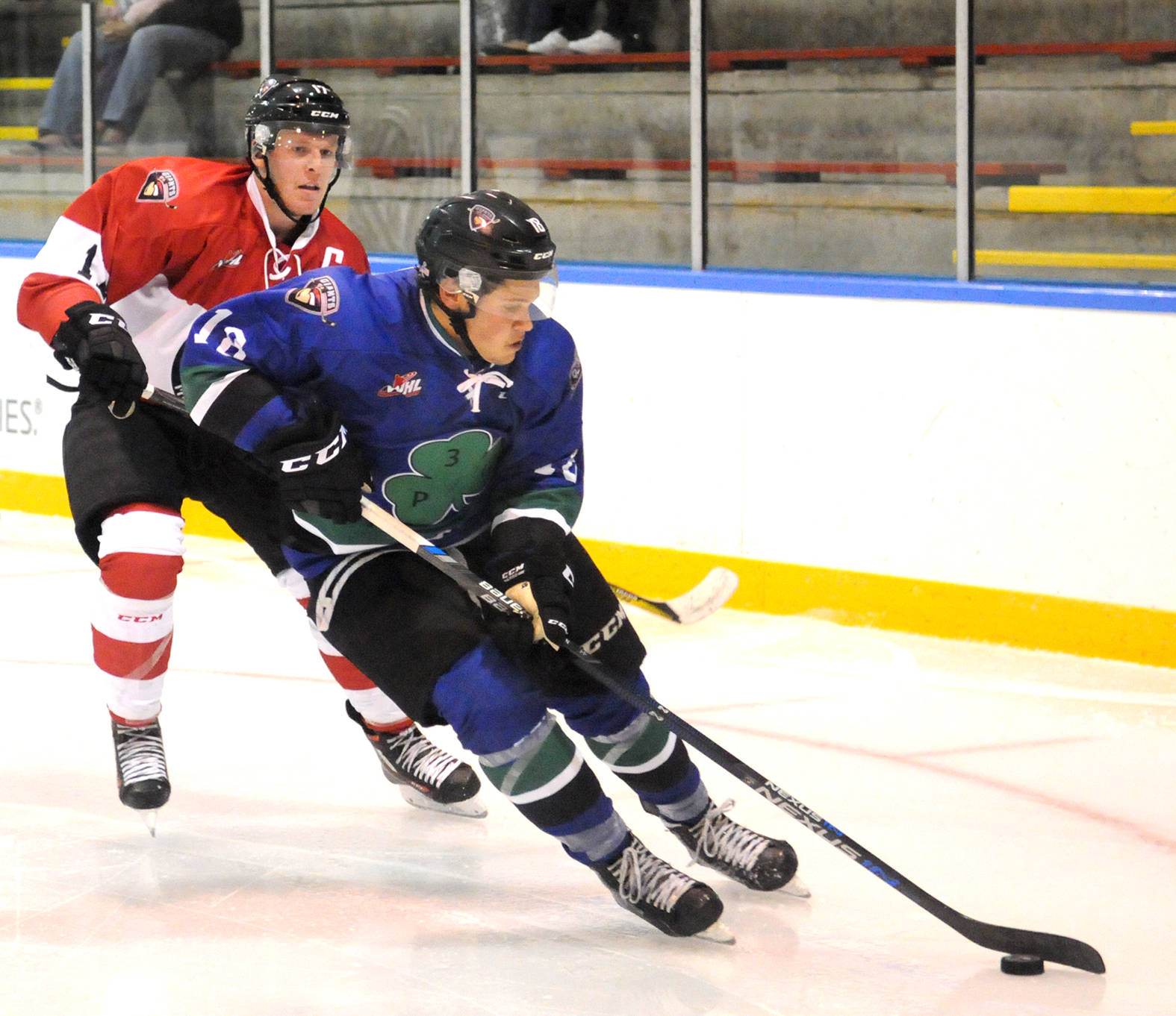 Jack Flaman (blue) is pursued by Tyler Benson during last year's Quinn/Howe Top Prospects Game during Vancouver Giants training camp. Benson is hoping to bounce back after missing the second half of last season while Flaman aims for one of three over-age spots on this year's Giants team. Gary Ahuja Langley Times file photo