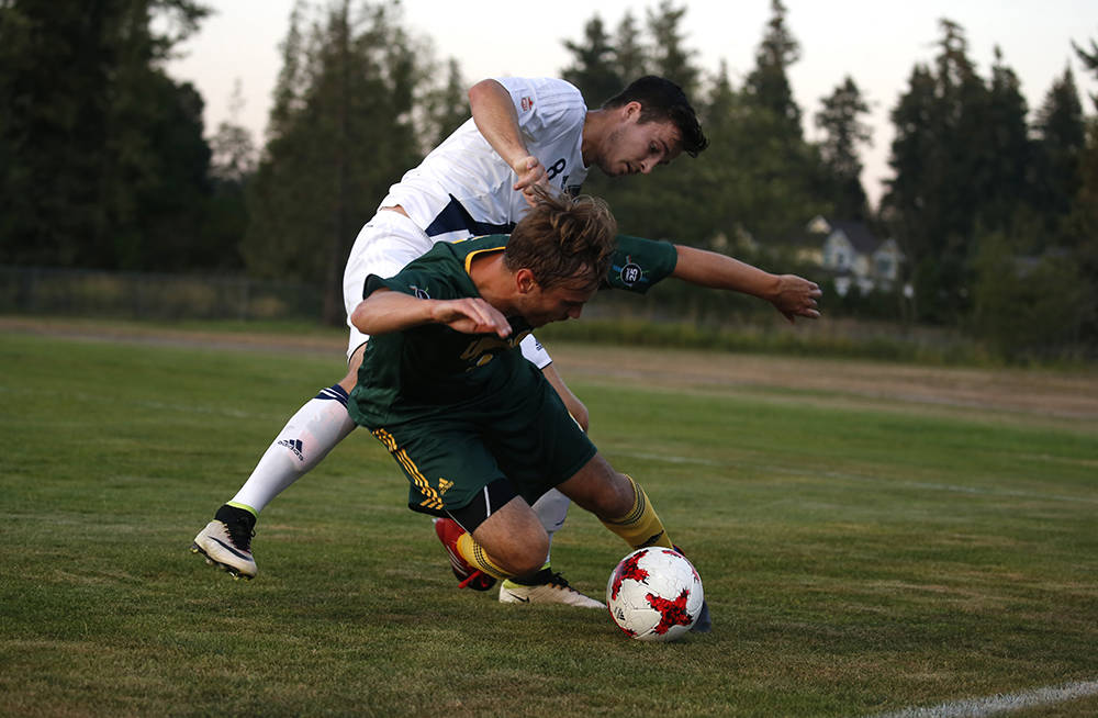 Trinity Western Spartans Leighton Johnson (left) battles UNBC Timberwolves' Conrad Rowlands during Canada West soccer action on Friday (Sept. 1) in a 0-0 draw. Johnson did score his team-leading fourth goal — which is also tied for the conference lead — the next night but the Spartans settled for a 2-2 draw. Scott Stewart TWU Athletics