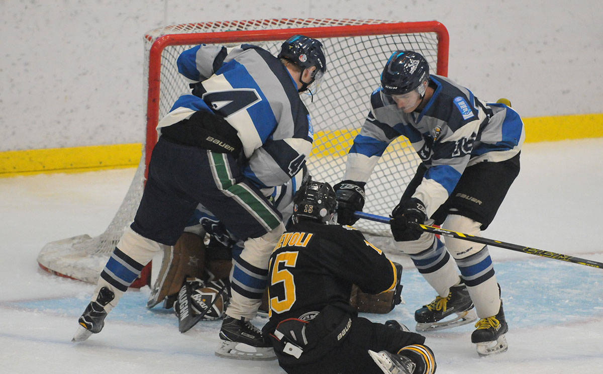 Langley Trappers' Ben Hamel (#16) keeps the front of the net clear during junior B hockey at the George Preston Recreation Centre on Sept. 6. Gary Ahuja Langley Times