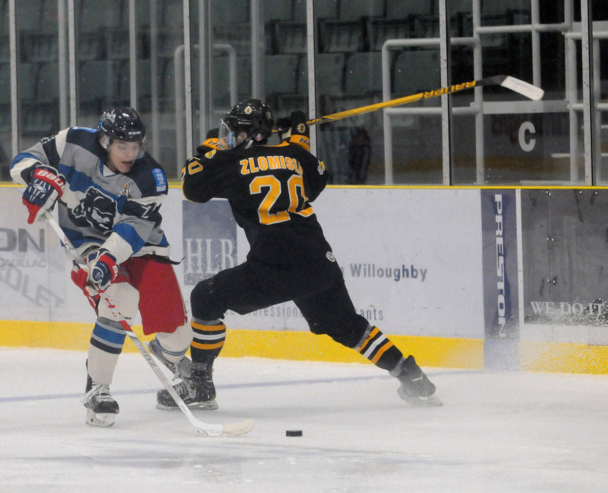Langley Trappers' Matthew Smoliga manoeuvres past Grandview Steelers' Kristofer Zlomislic during the junior B Trappers inaugural game on Wednesday night at the George Preston Recreation Centre. The Trappers had a succesful debut, winning 4-3. Gary Ahuja Langley Times