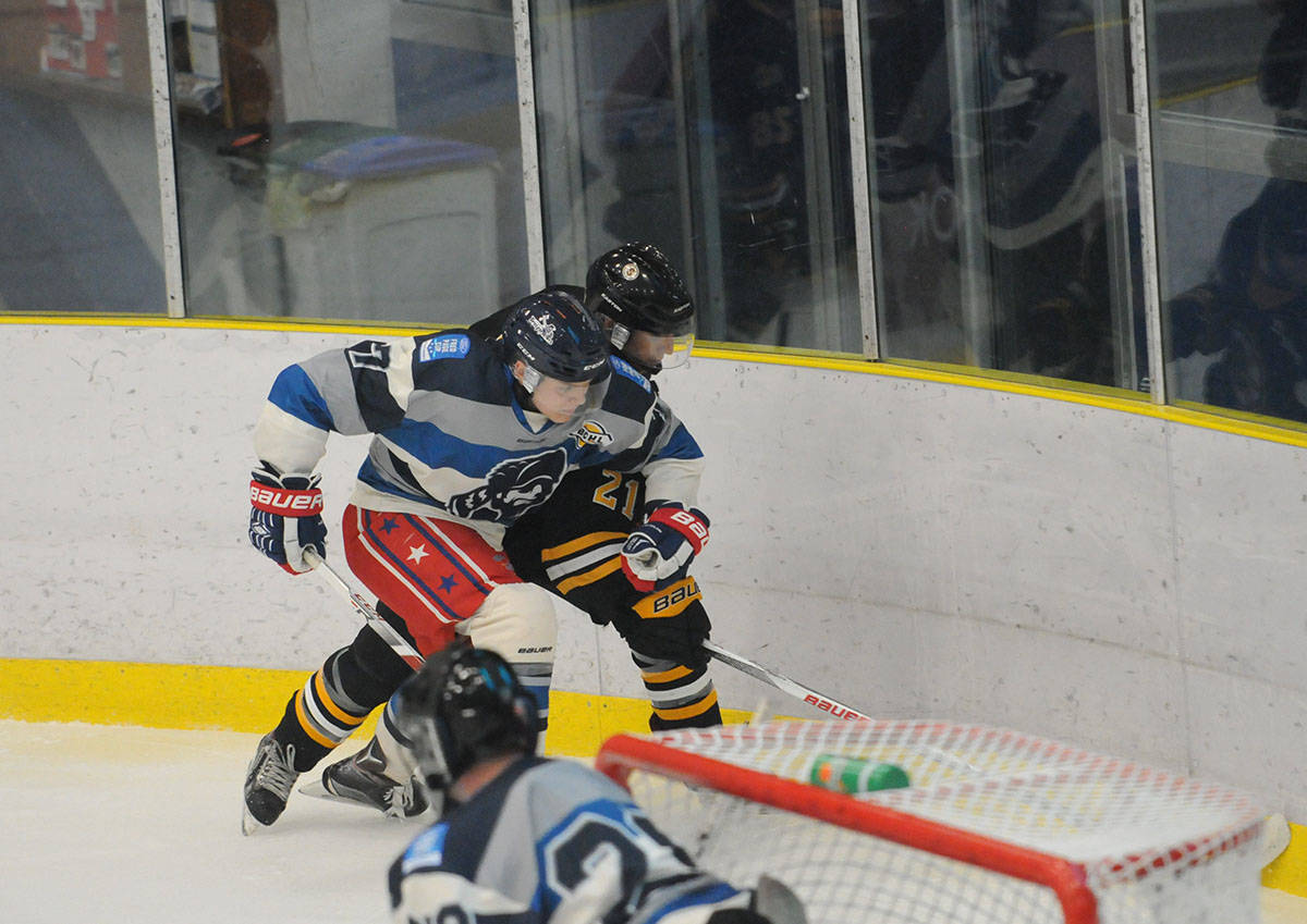 Langley Trappers' Matthew Smoliga rubs out his Grandview Steelers opponent during the junior B Trappers inaugural game on Wednesday night at the George Preston Recreation Centre. The Trappers had a succesful debut, winning 4-3. Gary Ahuja Langley Times