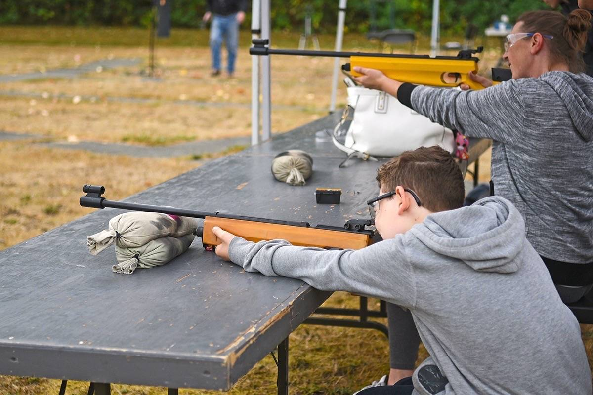 Jonah Prosser, 9, and mom Tami visited the Langley Rod and Gun Club for the very first time during the club's family fun day on Sept. 10. Miranda Gathercole Langley Times