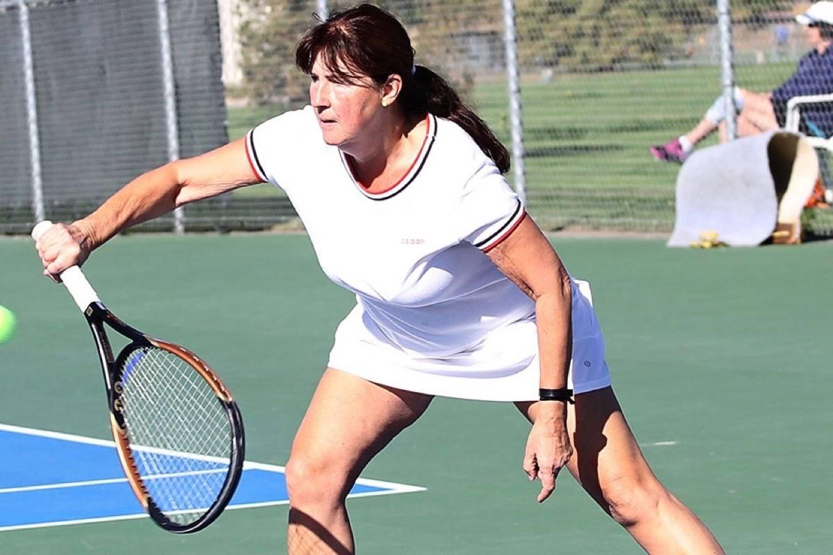 Silvia Hunt of Langley returns the serve in a BC 55+ games match Thursday morning at Marshall Field. Lisa Mazurek Black Press