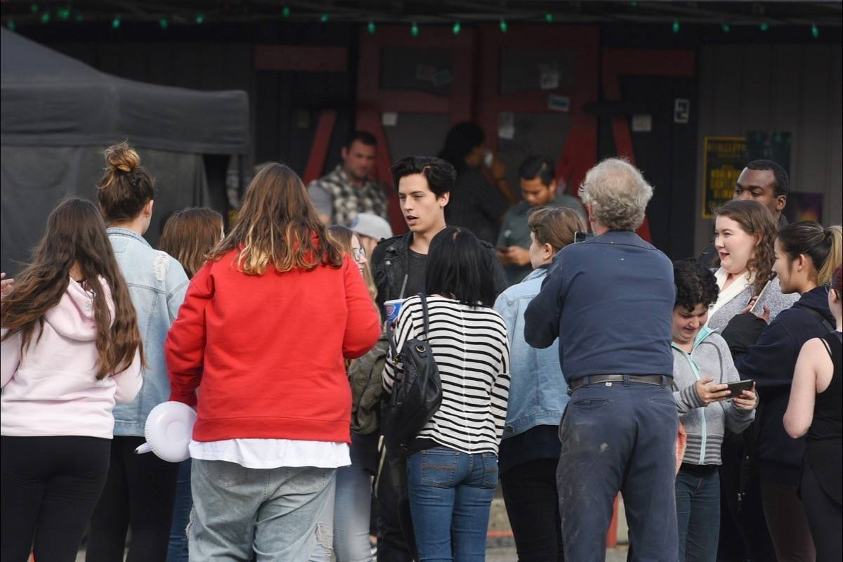 Fans of the popular television series Riverdale were rewarded for their patience on Tuesday afternoon when Cole Sprouse, who plays Jughead, stepped out to sign autographs and pose for photos. The cast was in Langley City filming at Gabby's on Fraser Highway. Miranda Gathercole Langley Times
