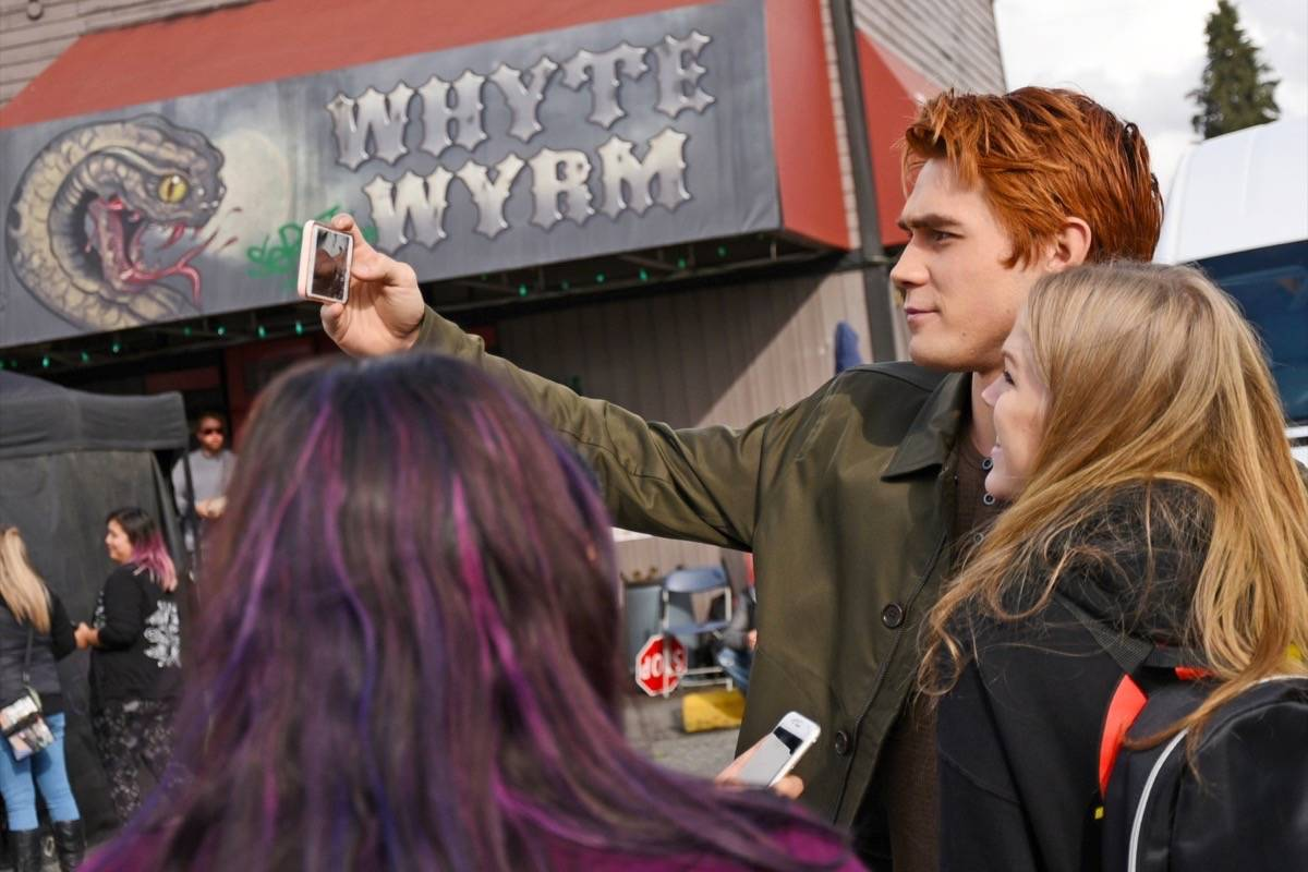 """Actor KJ Apa, who plays the character Archie in Riverdale, snapped a photo with a fan outside of Gabby's Country Cabaret, aka the """"Whyte Wyrm."""" Miranda Gathercole Langley Times"""