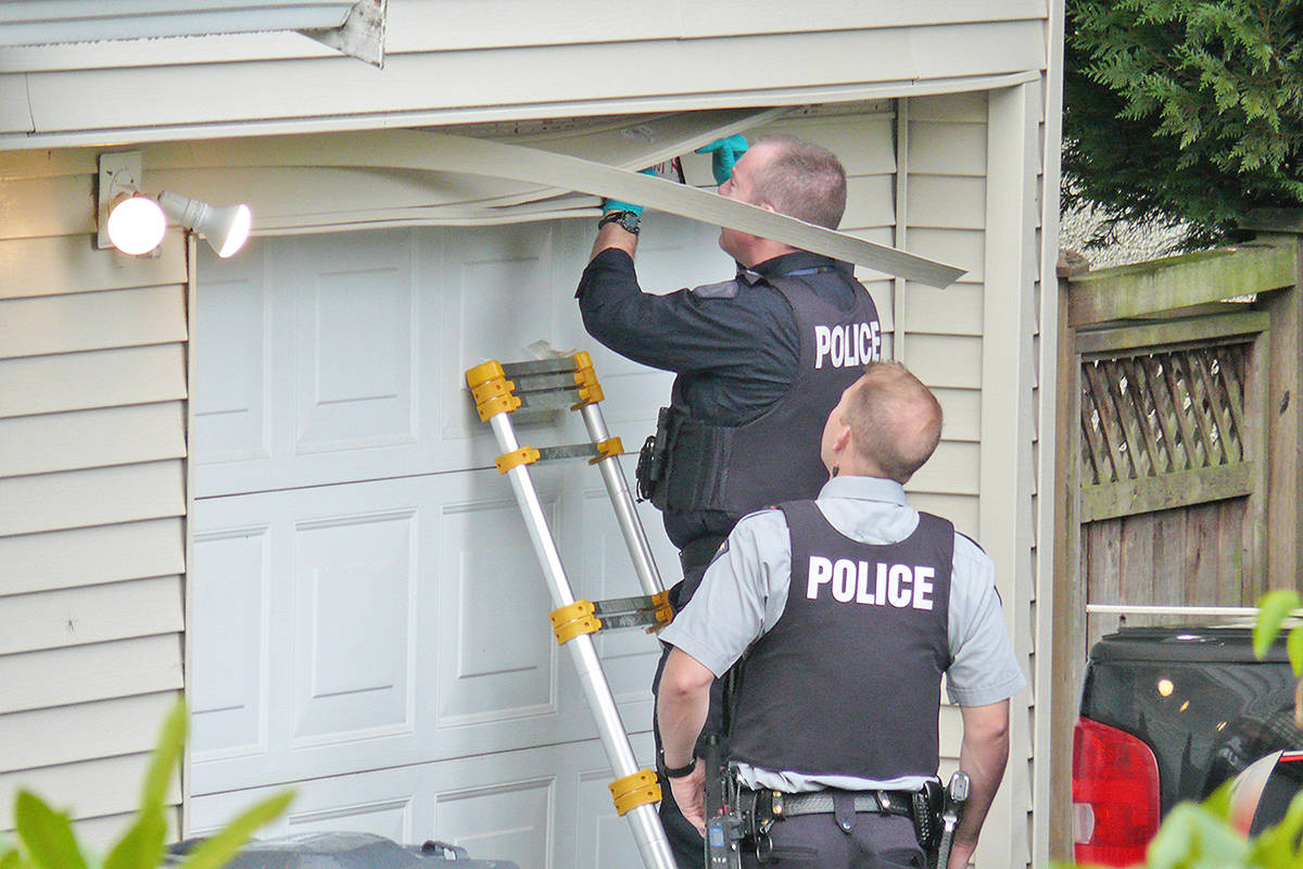Police removed what appeared to be a stray bullet from a nearby house across the street from an Aldergrove shooting incident on Wednesday. Dan Ferguson Langley Times
