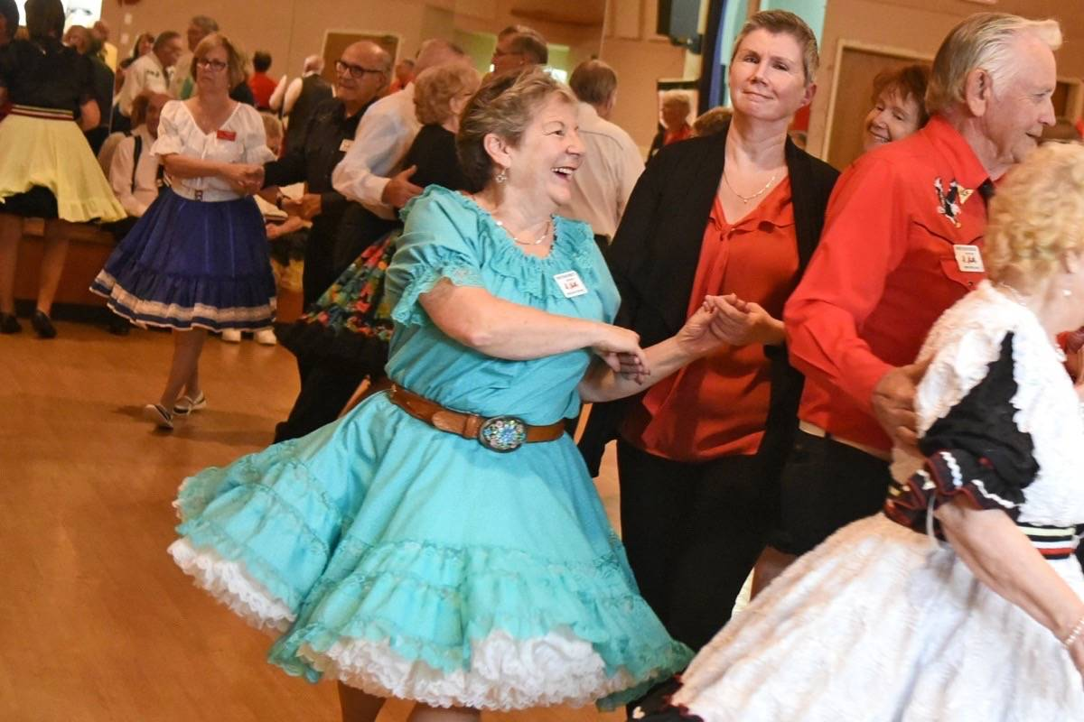 Caller Heather Reynolds of Abbotsford guides mainstream/plus dancers from the Surrey Square Wheelers Club through a variety of configurations on Tuesday night (Sept. 19). The club dances out of the Brookswood Senior Centre. See video at langleytimes.com.                                Miranda Gathercole Langley Times