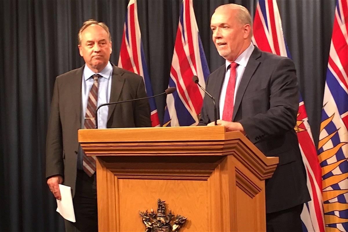 B.C. Greens leader Andrew Weaver and Premier John Horgan announce legislation banning corporate and union donations at the B.C. legislature, Sept. 18, 2017. (Tom Fletcher/Black Press)