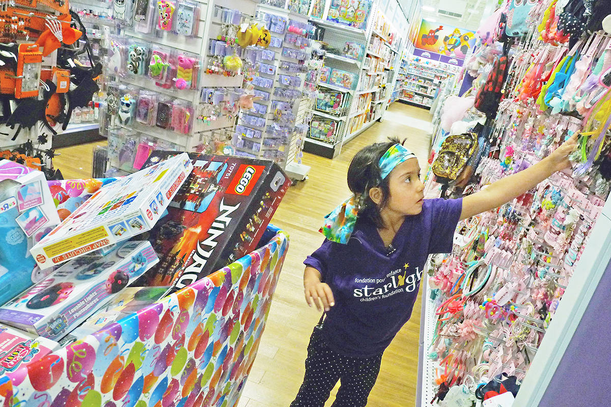 "Talia Mahseredjian had three minutes to collect all the toys she could. The young cancer patient and her family filled several buggies during an early morning spree at the Langley Toys ""R"" Us store. Dan Ferguson Langley Times"