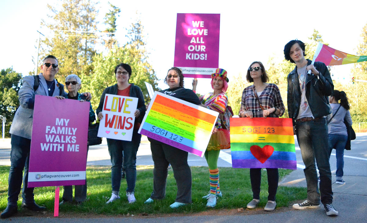 More than 100 people rallied in support of inclusive education around LGBTQ youth outside the Langley School District office on Tuesday. Rally organizer Stacey Wakelin (second to left) also spoke at the school board meeting that night in support of the SOGI curriculum. Monique Tamminga Langley Times