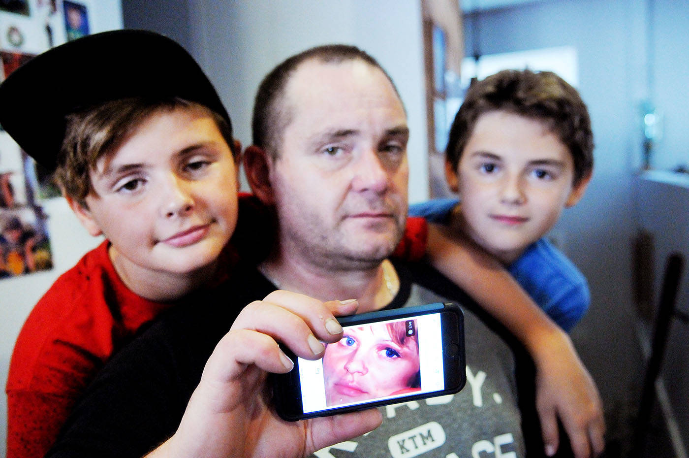 Danielle 'Deedee' Charlton's estranged husband Charlie Charlton held a photo of Deedee. On either side of Charlie is his and Deedee's sons Charles, 13, and Danny, 12. Deedee was killed in a car crash outside Hope on Sept. 11. The suspect who is thought to have fled the scene of the crash is now in custody. Troy Landreville Langley Times