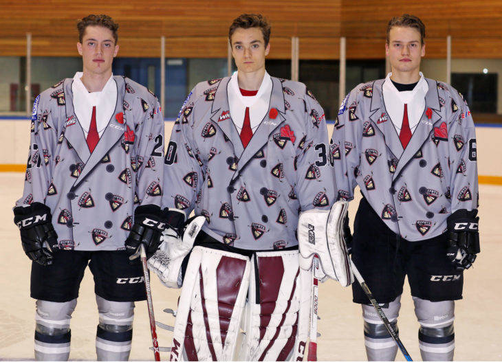 Brendan Semchuk (left to right), David Tendeck and Dylan Plouffe model the special jerseys the Vancouver Giants will wear on Oct. 7. Bids are being accepted for the Don Cherry-inspired jerseys. Rik Fedyck Vancouver Giants photo