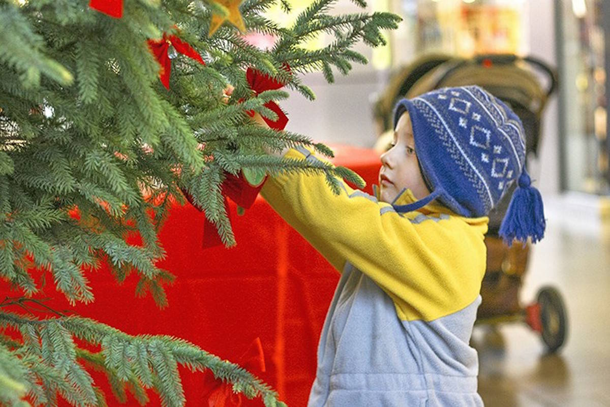 Logan Ninaus of Langley attaches his tag to the Christmas Bureau Tree. Times file photo