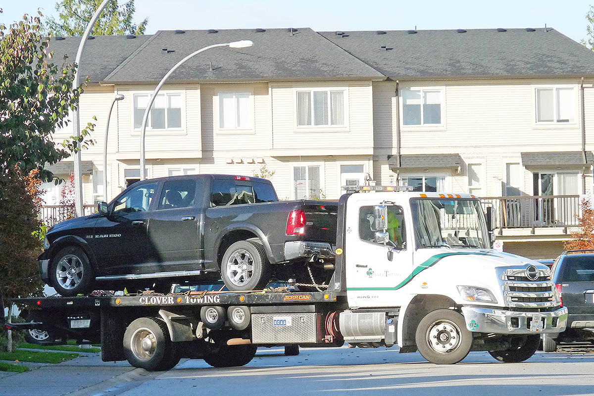 A tow truck removes a pickup from the scene of a drive-by shooting in Willoughby. It had one flat tire. Dan Ferguson Langley Times.