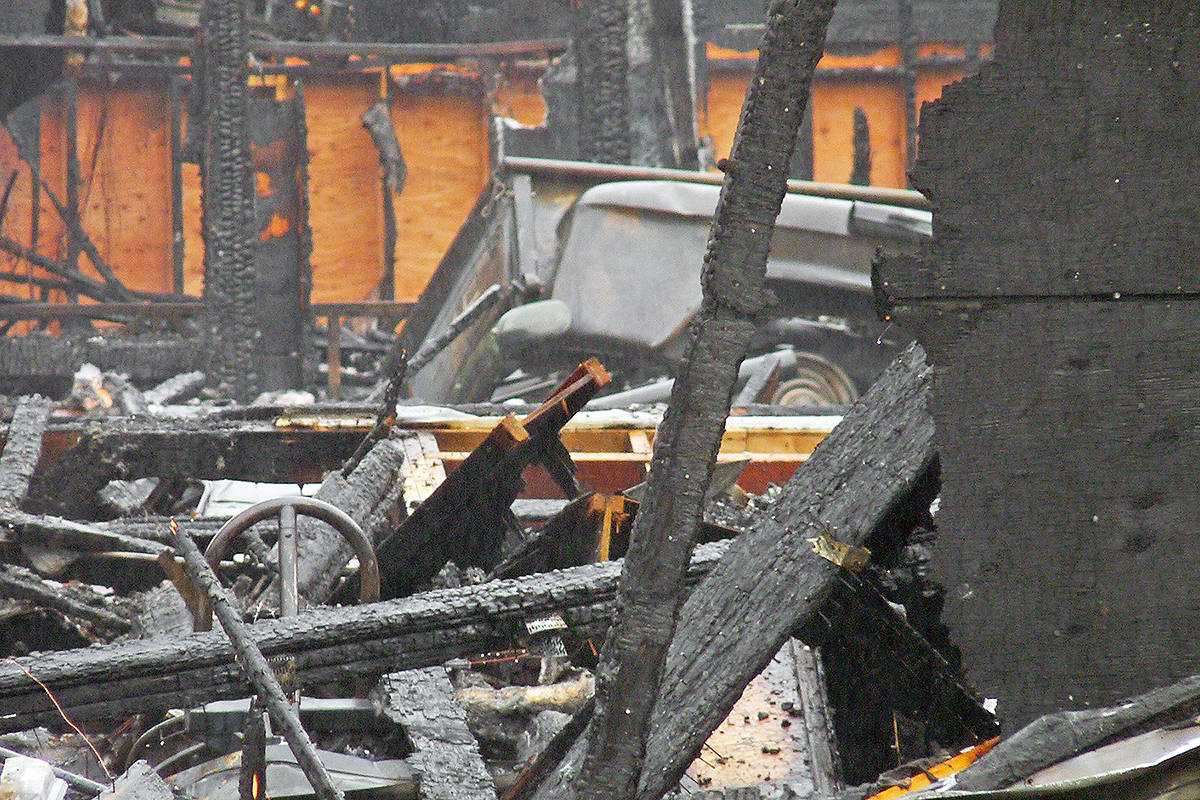 The wreckage of a classic pickup truck could be seen inside a burned-out Langley garage. It was one of more than 30 collectible vehicles lost in the Wednesday morning blaze. Dan Ferguson Langley Times