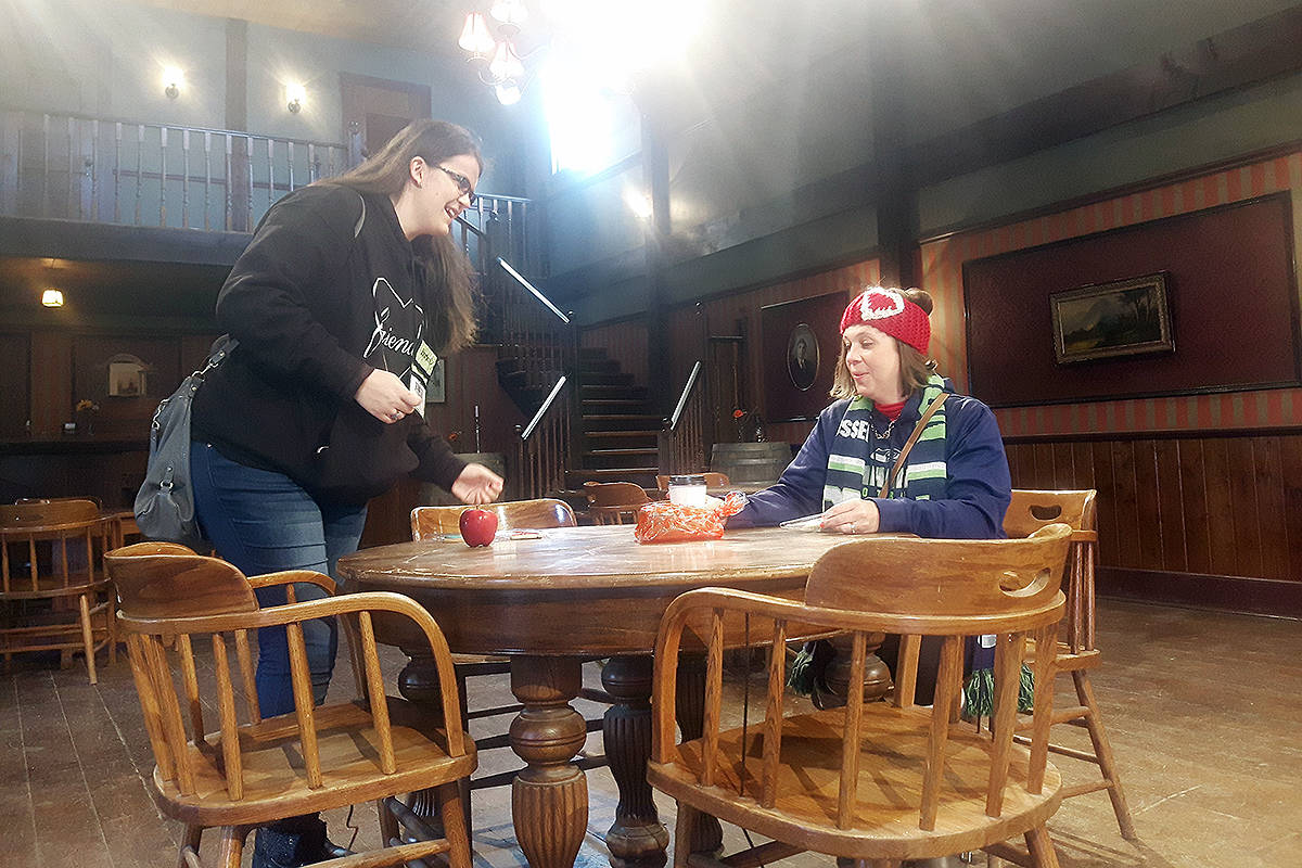"Jennifer Pelletier from South Dakota and Megan Depping from Washington State took a seat in the Langley saloon set of their favourite series. They were among more than 400 ""hearties"" who paid the set a visit Sunday. Dan Ferguson Langley Times"
