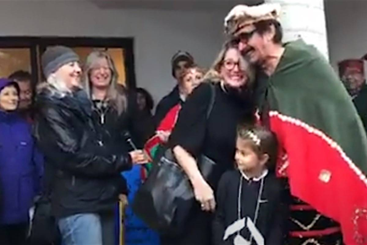 Agriculture Minister Lana Popham hugs George Quocksister, one of the leaders of a two-month protest occupation of Marine Harvest salmon farms, at a fundraiser for Courtenay-Comox MLA Ronna-Rae Leonard in Courtenay, Oct. 21, 2017. At left is Alexandra Morton, anti-fish farm activist who has also participated in the protest. (Facebook)