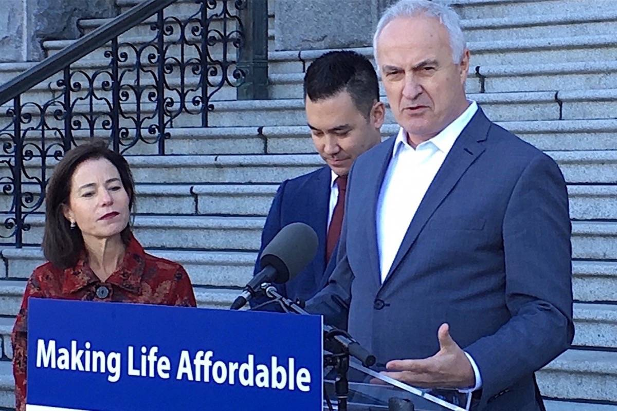 Municipal Affairs and Housing Minister Selina Robinson, Andrew Sakamoto of the Tenant Resource and Advisory Centre and David Hutniak, CEO of LandlordBC, announce new rent restrictions at the B.C. legislature, Oct. 26, 2017. (Tom Fletcher/Black Press)