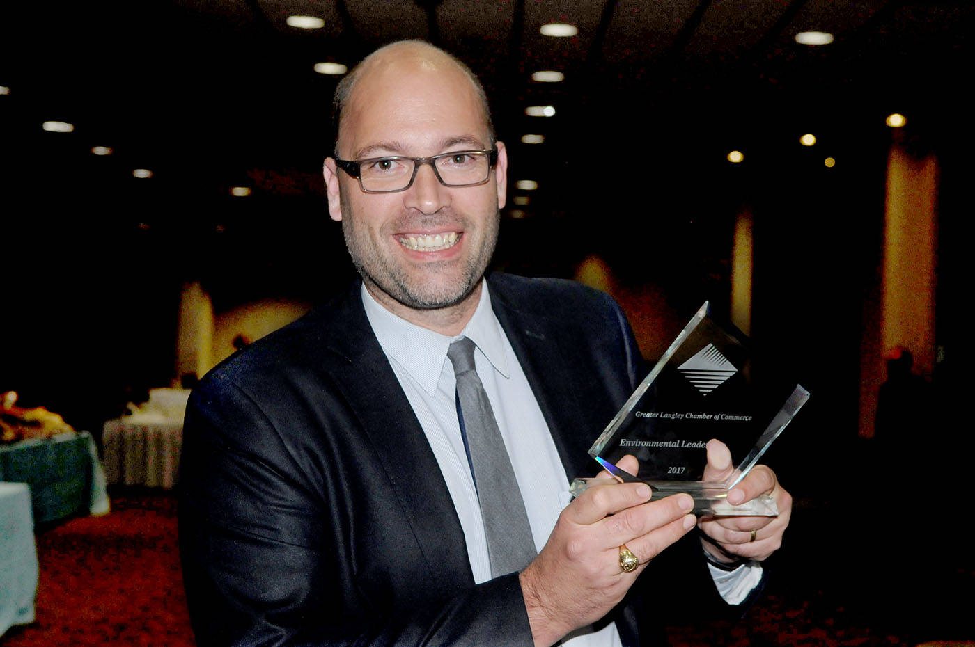 Steve Lewarne, Chief Executive Officer of the Kwantlen Polytechnic University Foundation, held the Environmental Leadership Award during the Langley Business Excellence Awards at the Coast Hotel ballroom. Troy Landreville Langley Times