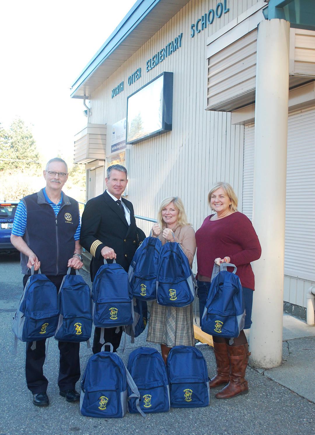 KURT LANGMANN PHOTO Aldergrove Rotarian Charlie Fox and Jazz Airline Captain Dan Rowbotham delivered 10 Starfish backpacks of food to North Otter Elementary principal Dianne Chretien and youth worker Ulla Thomas this past week.