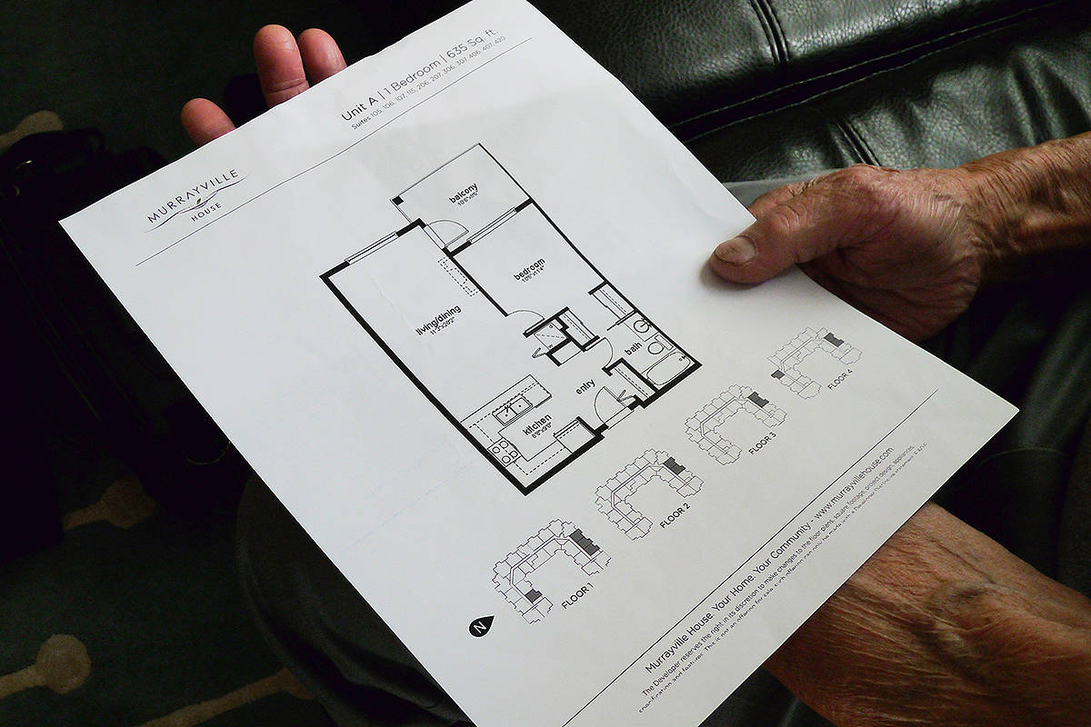 A Murrayville House buyer shows the floor plan of the suite he purchased. The new condo has been completed, but remains unoccupied because of several lawsuits against the builder. Dan Ferguson Langley Times