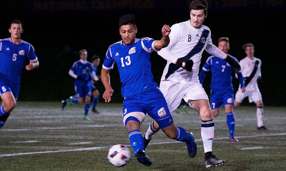 UBC midfielder Kerman Pannu and Trinity Western University forward Leighton Johnson battled for ball control during the Canada West men's soccer final Saturday at UBC's Thunderbird Stadium. Trinity Western University Athletics photo