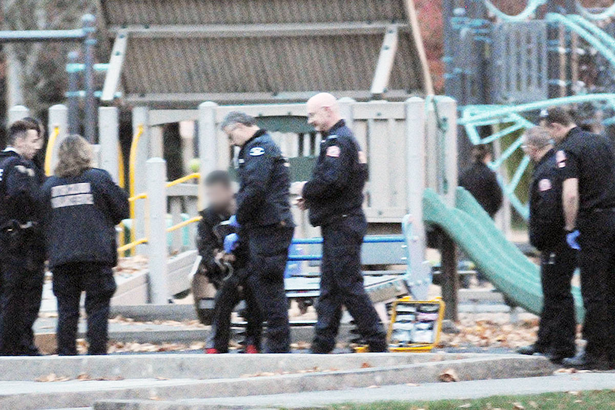 Fire, ambulance and police were called to a report of a suspected drug overdose in a Langley City park on Tuesday. The photo has been altered to blur out the face of the suspected victim. Troy Landreville Langley times