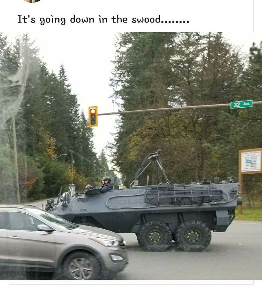 Lower Mainland Emergency Response Unit armored vehicle drives along 32 Avenue in Brookswood Wednesday morning. The ERT was part of a major takedown of a gang unit allegedly trafficking drugs in properties in Langley and Surrey.                                Photo courtesy of the Brookswood Facebook page