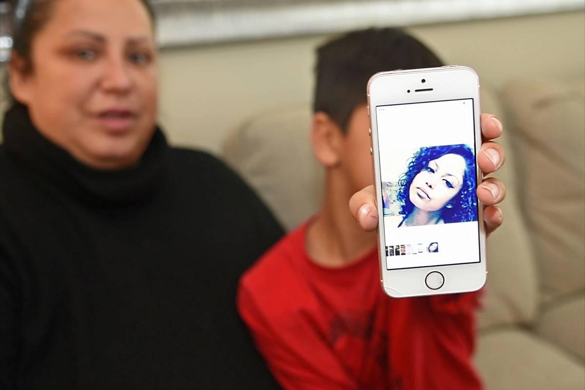Jennifer Anaquod and her son, Jonathan, 8, hold up a picture of Shantee. Miranda Gathercole Langley Times