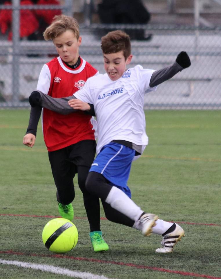 ART BANDENIEKS The U12 Aldergrove Whitecaps in action against Surrey United Saturday morning. All soccer games played on the weekend observed a moment of silence and contemplation in respect of Remembrance Day.