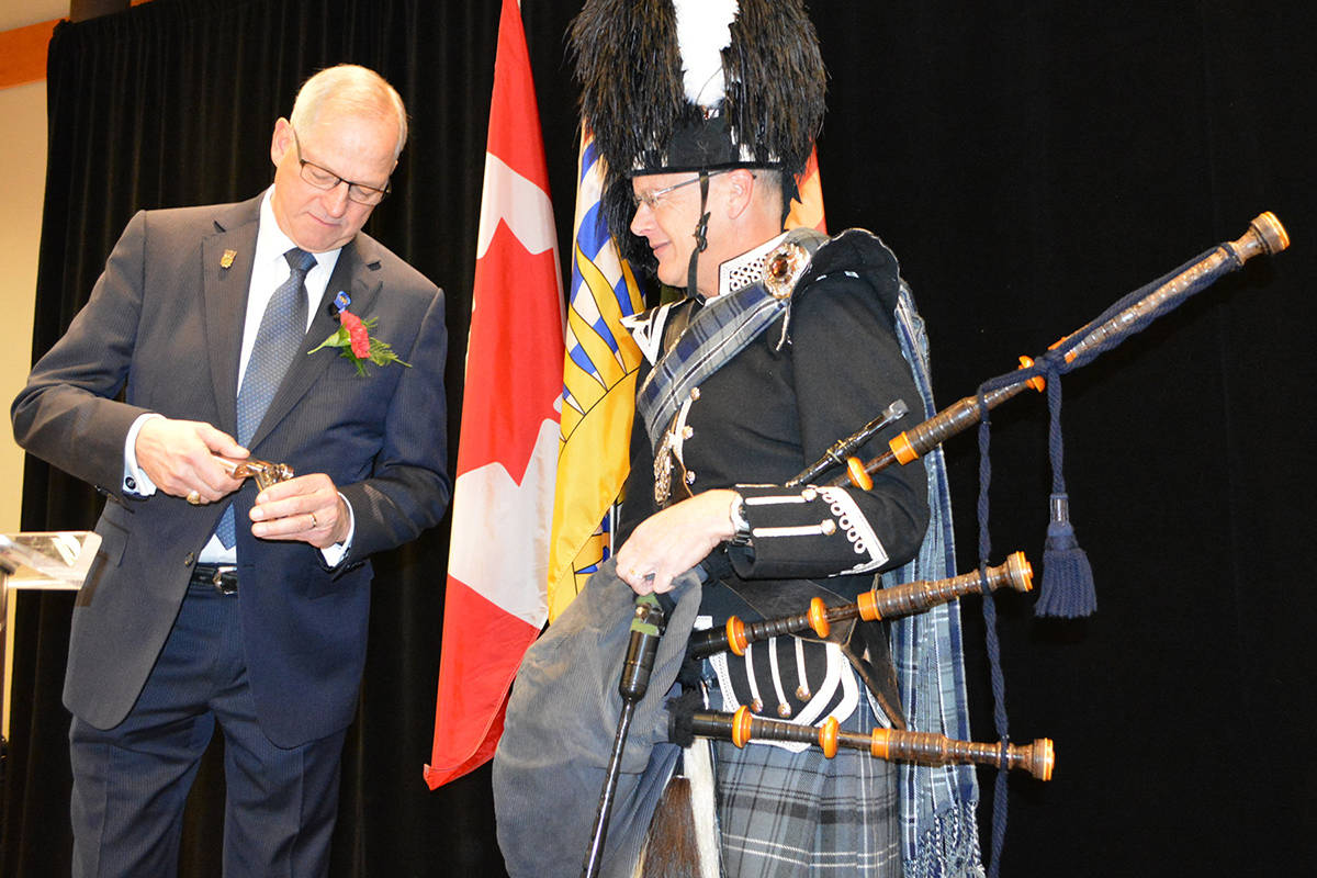 Mayor Jack Froese pays the piper. Submitted photo