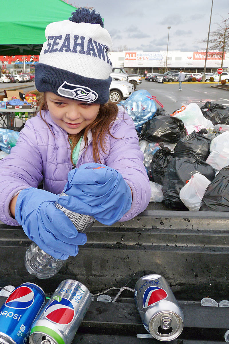 """Seven-year-old Keira Terry sorts cans and bottles at the """"Team Keian"""" bottle drive. Dan Ferguson Langley Times"""