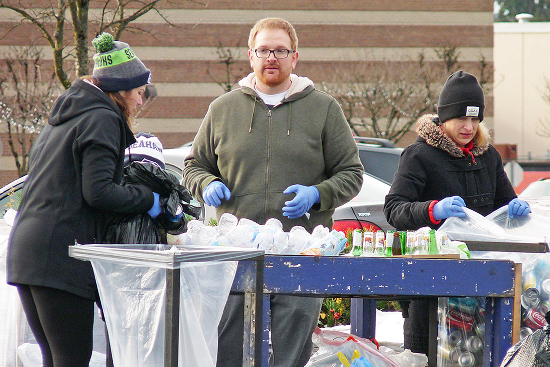 """Melanie Terry, Ryan Blundell and Teera Jacobs sort cans and bottles at the """"Team Keian"""" fund-raiser. Dan Ferguson Langley Times"""