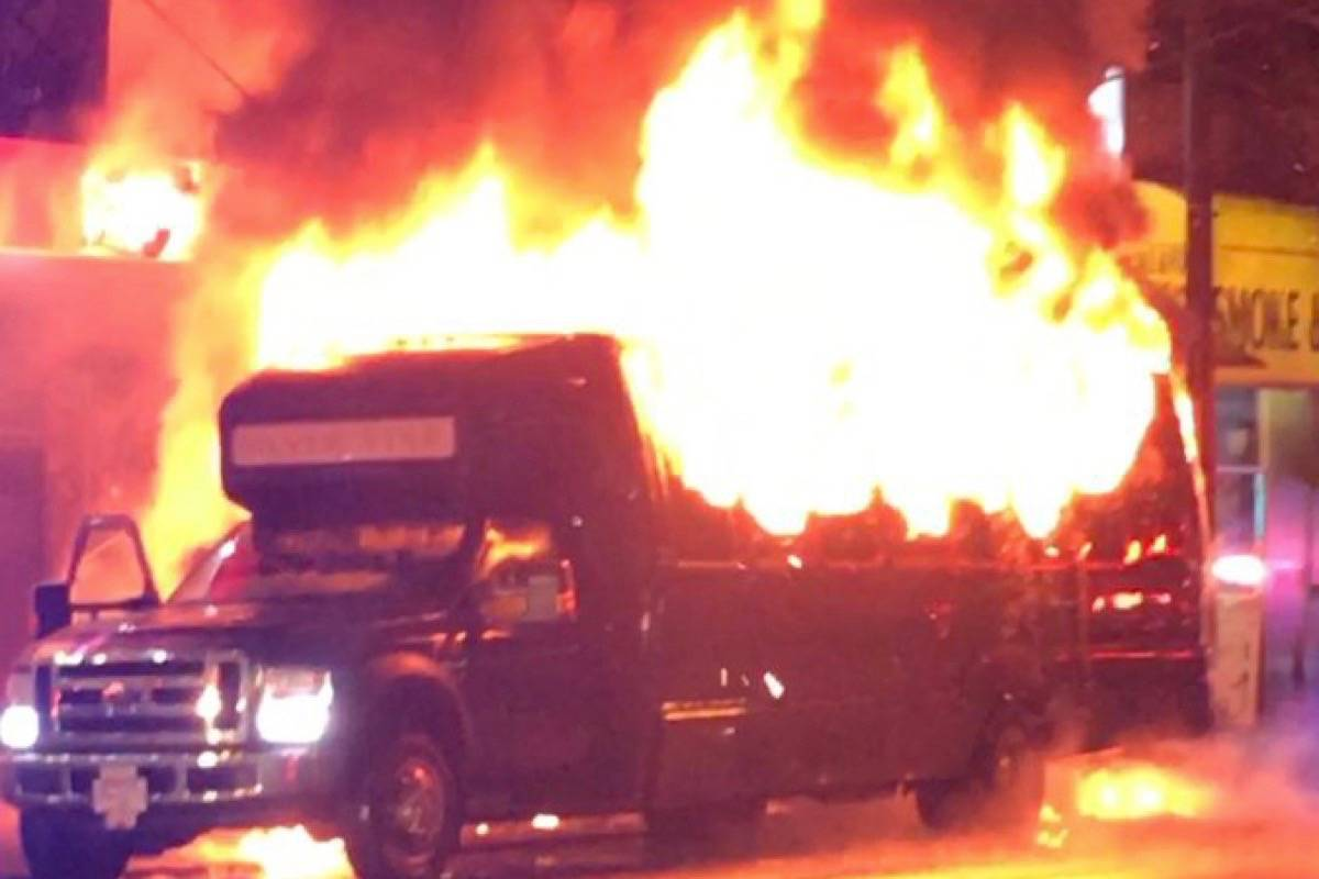 A 'party bus' lit on fire in Vancouver Saturday night. (tyler-roxy/Twitter)