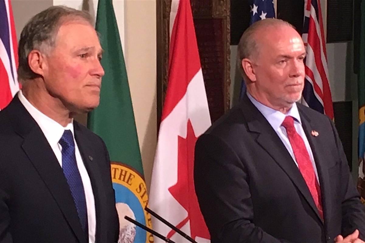 Washington Gov. Jay Inslee and B.C. Premier John Horgan take questions at the B.C. legislature, Nov. 21, 2017. (Tom Fletcher/Black Press)