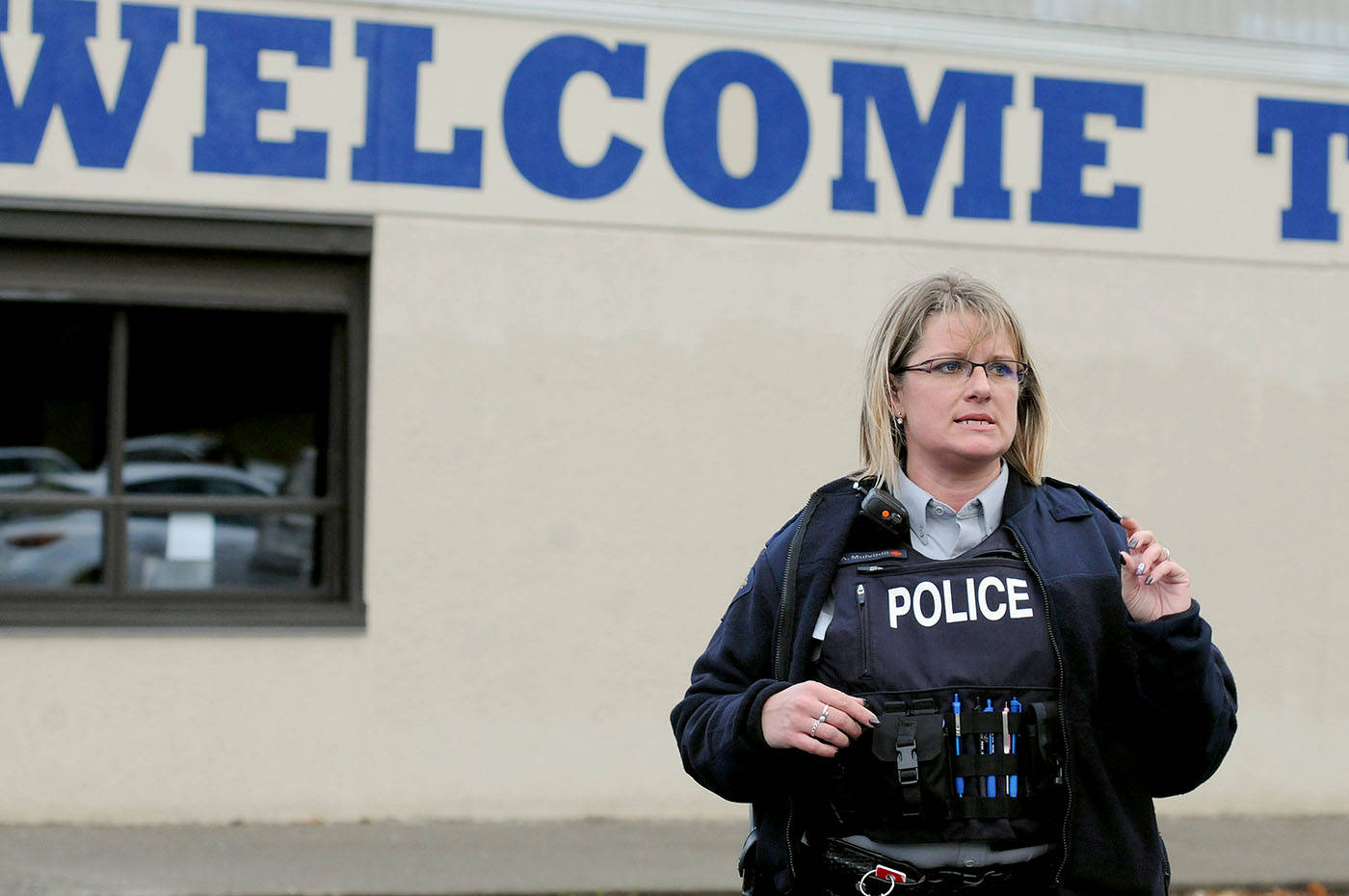 Langley RCMP Sgt. Alex Mulvihill addressed concerned parents waiting for their children after Brookswood Secondary School was put under lockdown Wednesday afternoon. Troy Landreville Langley Times