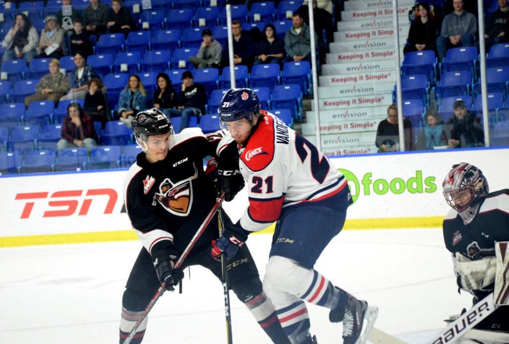Vancouver Giants Kaleb Bulych against the Lethbridge Hurricanes' Ryan Vandervlis during WHL action at the Langley Events Centre on Nov. 22. Gary Ahuja Langley Times
