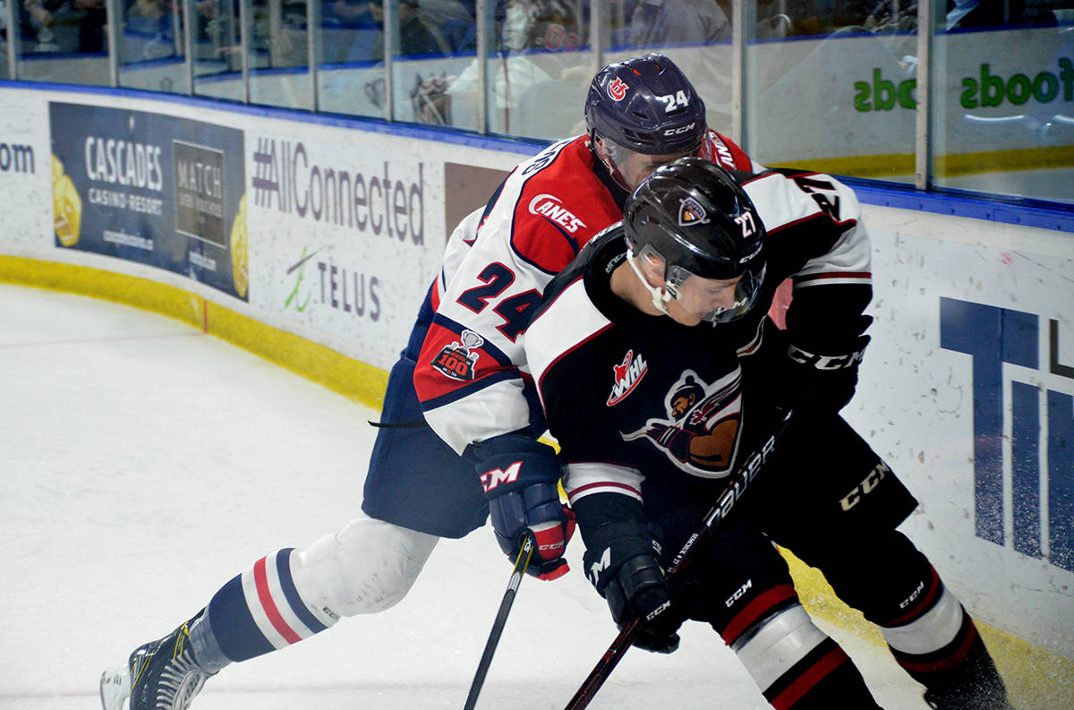 Vancouver Giants Brendan Semchuk fends off Lethbridge Hurricanes' Dylan Cozens during WHL action at the Langley Events Centre on Nov. 22. Gary Ahuja Langley Times
