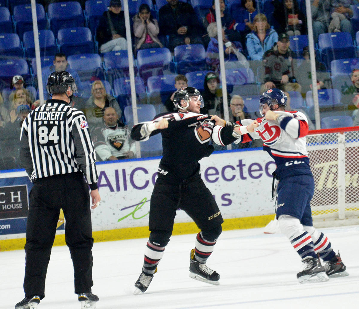 Vancouver Giants Darian Skeoch and Lethbridge Hurricanes' Tanner Nagel drop the gloves, Langley Events Centre on Nov. 22. Gary Ahuja Langley Times