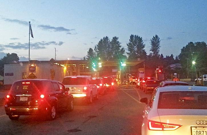 Traffic lines up at the Aldergrove border crossing. Aldergrove spiritual leader Joga Singh Badwal was given at 15-month conditional sentence for bringing people into Canada from the U.S. without presenting them for examination by Canadian border officials.                                File photo