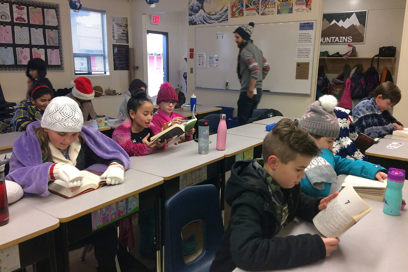 Students in Garrison Hodgins' Grade 5 class bundle up against the chilly air, as the heaters were turned off for the day.