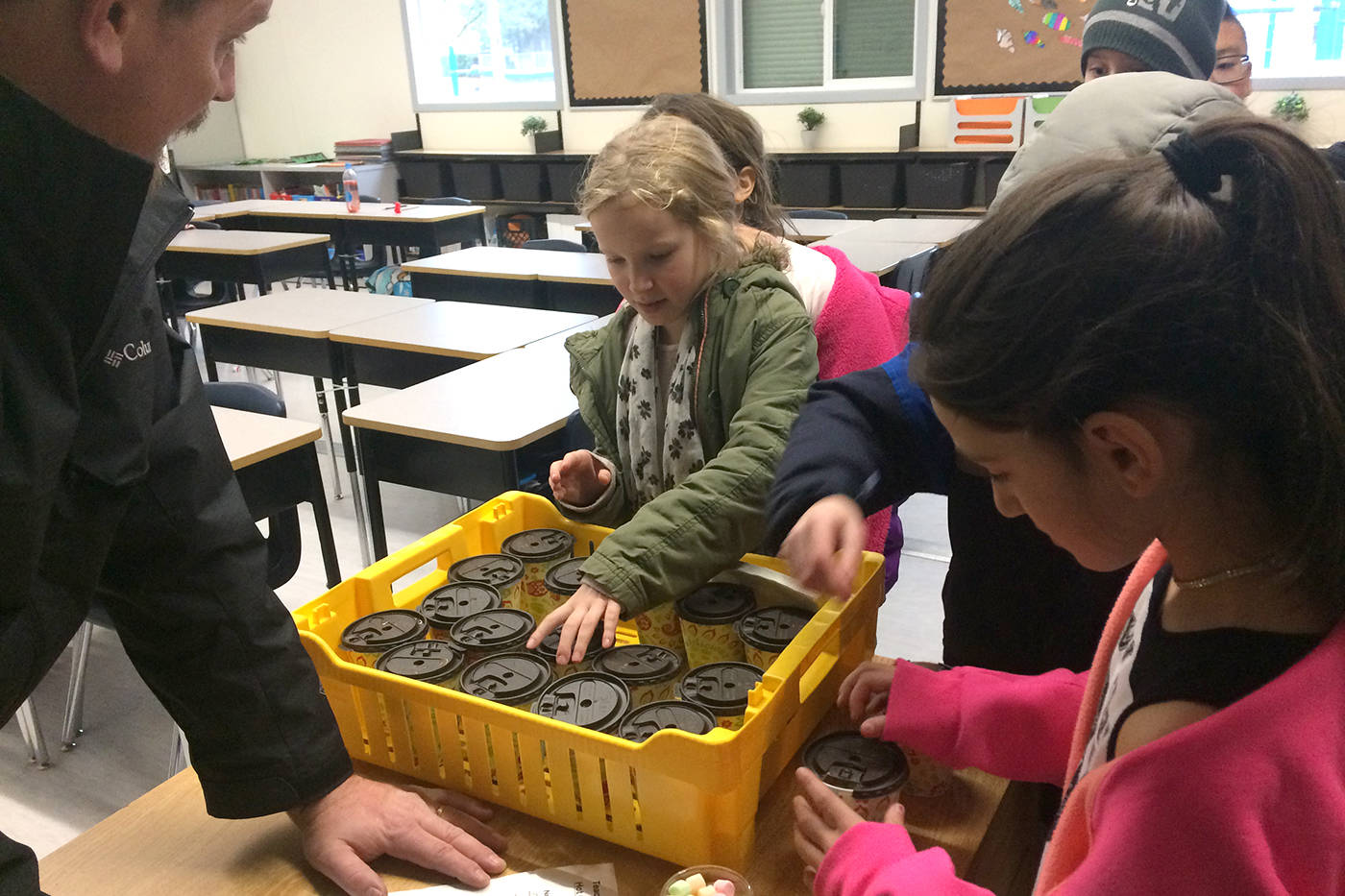 Students in Andy Fast's Grade 4 class take their hot chocolate, a fundraiser that coincided with the Coldest Day of the Year campaign.