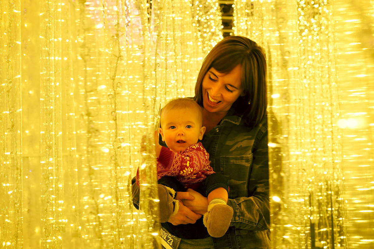 Melissa Dionne and six-month-old Finley were two of the first to visit the Glow Christmas display at Milner Gardens. Miranda Gathercole Langley Times.