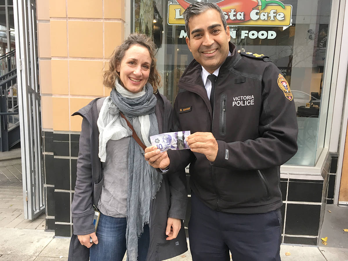 VicPD Chief Del Manak rescues a lost $10 bill dropped by a Victoria woman on Broughton at Douglas Street Friday afternoon. (Lauren Boothby/VICTORIA NEWS)
