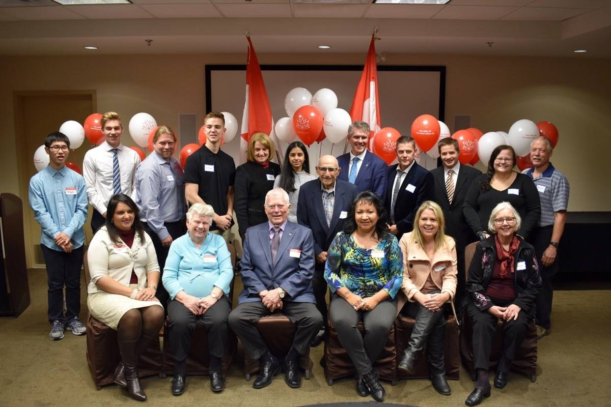"""The recipients of the Canada 150 awards in Cloverdale and Langley. Back row, from left: Joon Sohn, Liam Roberts, Fraser Holland, Nathan Bowick, Shelley Goepel, Harjot Kular, Bruno Zappone, John Aldag, Dean Moore, Tom Waldock, Traci Penner, Kevin Penner. Front row, from left: Jas Cheema, Gertrude """"Toots"""" Tucker, Roger Bose, Karen Moraes, Shauna Sawicki, Marilyn Fischer. (Sam Anderson)"""