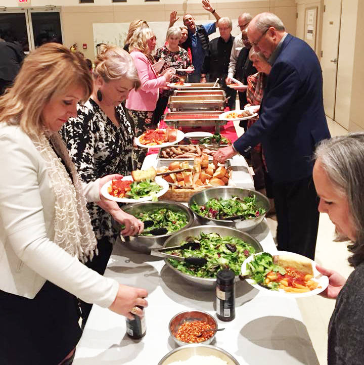Diners load up their plates at the Aldergrove Rotary Club's annual Past Dinner, a fundraiser for the club's Starfish Food Backpack program.