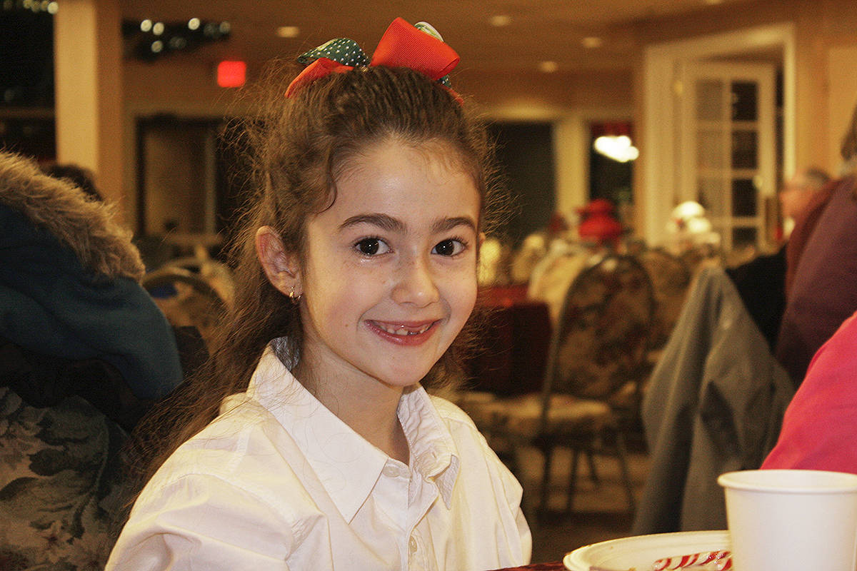 Nicole Benshimol, 8, wore holiday colours to breakfast at the Newlands Golf and Country Club Tuesday morning. The Langley City Event was the first Children's Wish Breakfast in the Fraser Valley. Dan Ferguson Langley Times