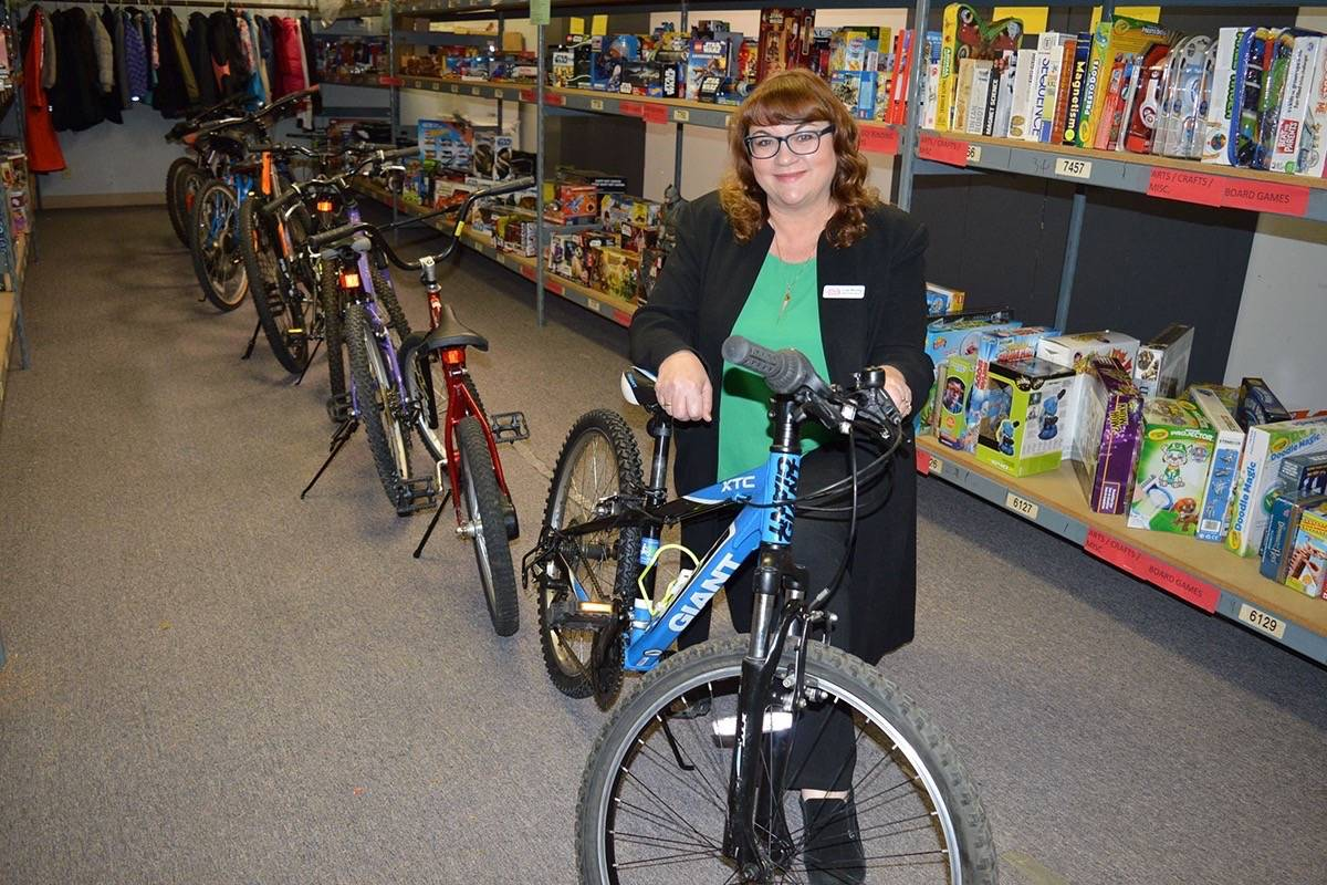 Photo: Tom Zytaruk                                Lisa Werring, executive director of the Surrey Christmas Bureau, with donated bikes.