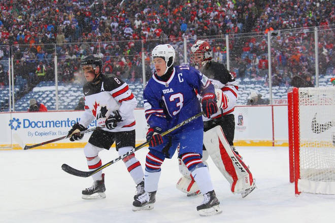 Team Canada defenceman, and Penticton Vees alumni, Dante Fabbro stands guard in front of goaltender Carter Hart as U.S. player Joey Anderson is posted in front.                                USA Hockey images